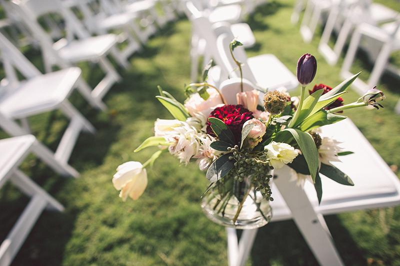 Tulip, Eucalyptus, Scabiosa Pod, and Protea Aisle Floral Arrangements