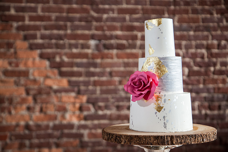 White Stacked Gold Painted Wedding Cake with Pink Rose