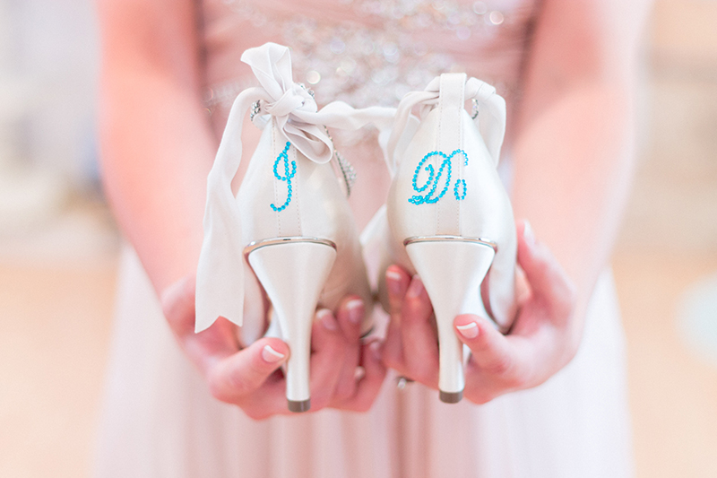 "white heels with blue 'I do"" crystals"
