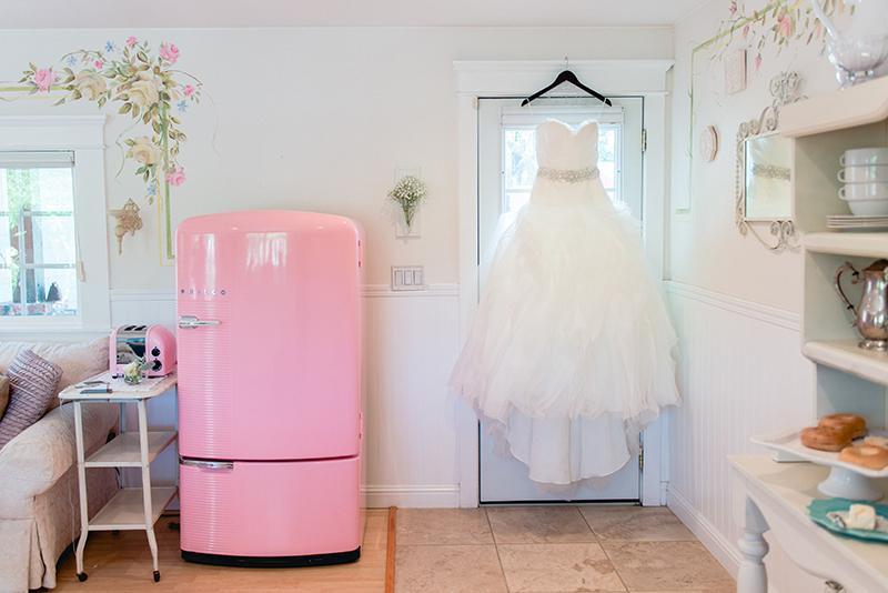 white ruffled strapless wedding dress
