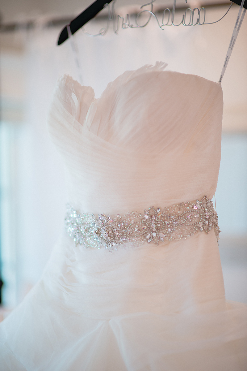 white strapless beaded waistline gown