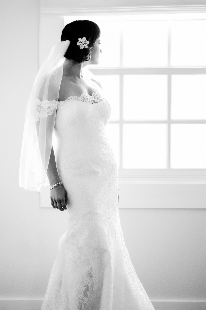 Black and white editorial shot of bride in veil