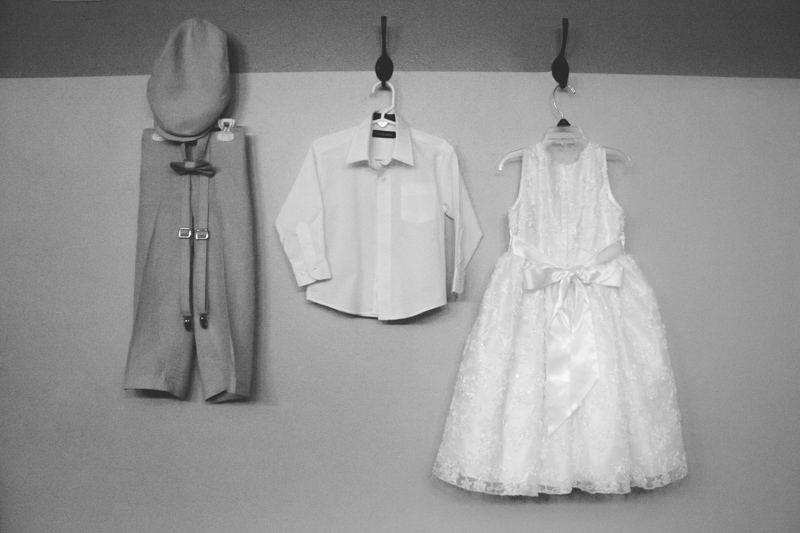 Black and white shot of ring berrier and flower girl outfits