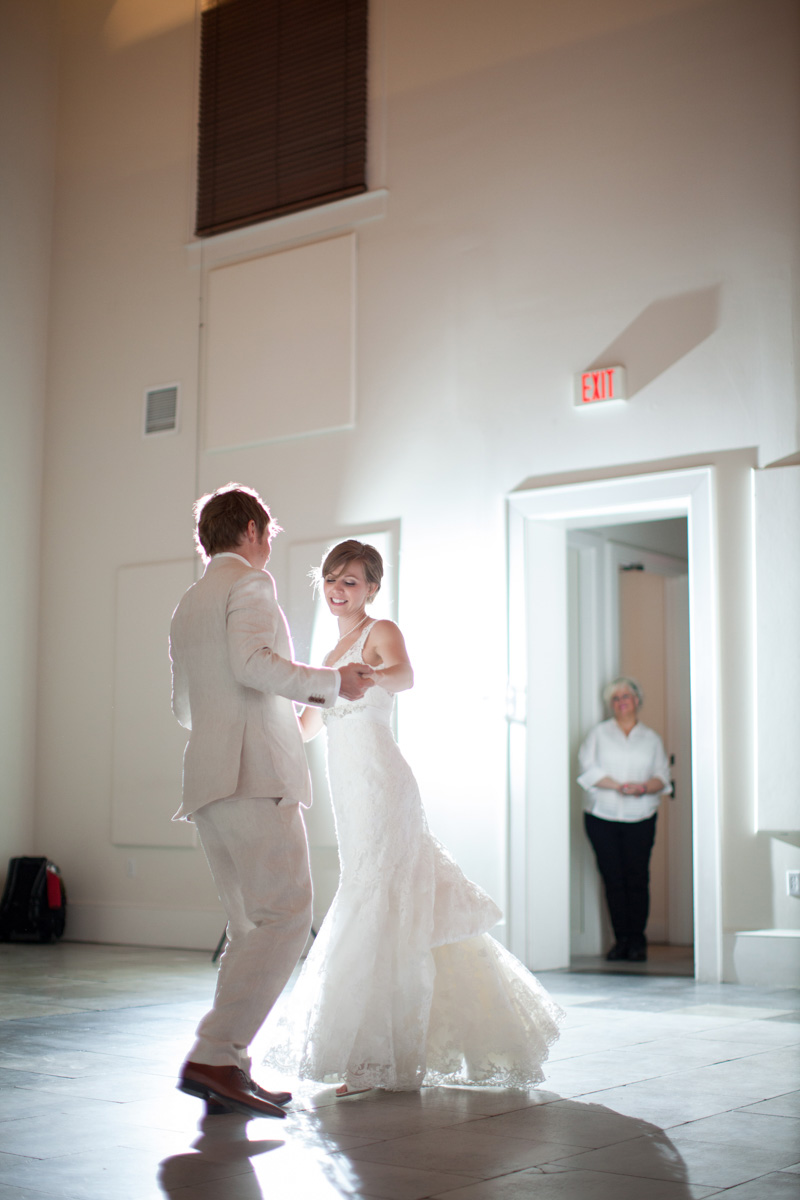 Bride and groom twirling during first dance