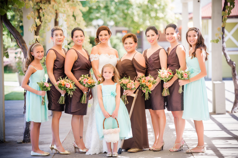 Bride with bridemaids and junior bridesmaids in light blue dresses