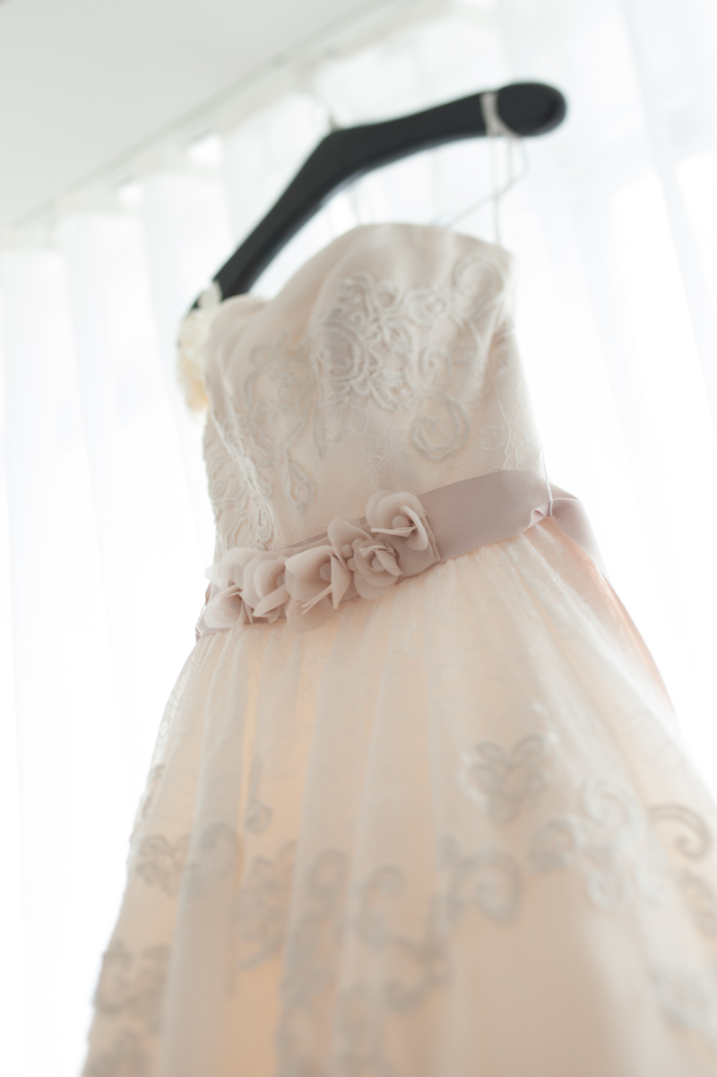 Brides ivor lace gown hanging