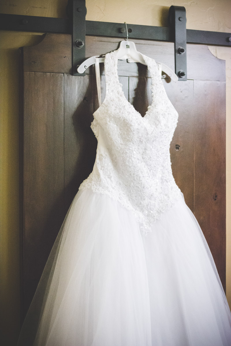 Bride's white beaded halter ballgown