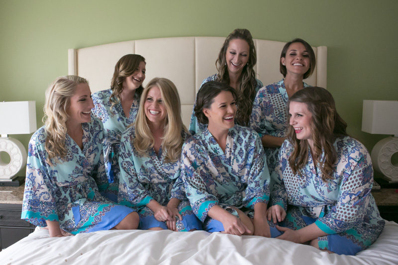 Bridesmaids in Robes on Bed Lauging
