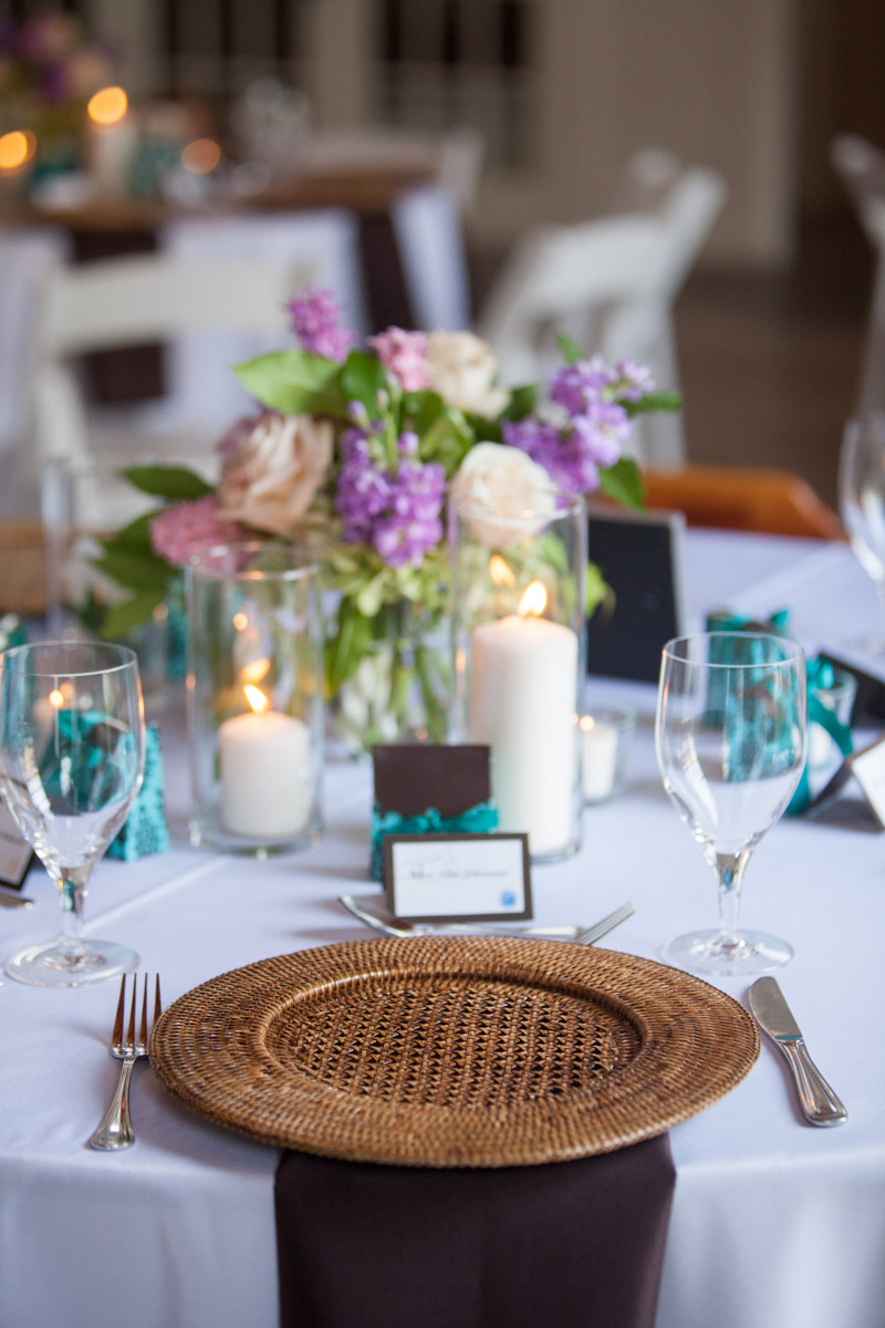 Close up of wicker plates on white table runner