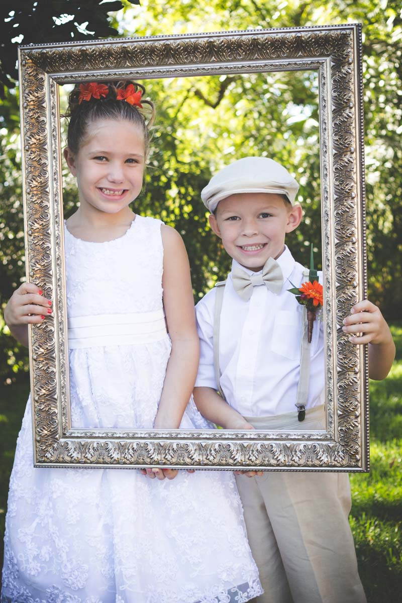 Gold guilded frame with ring berrier and flowergirl in white and khaki