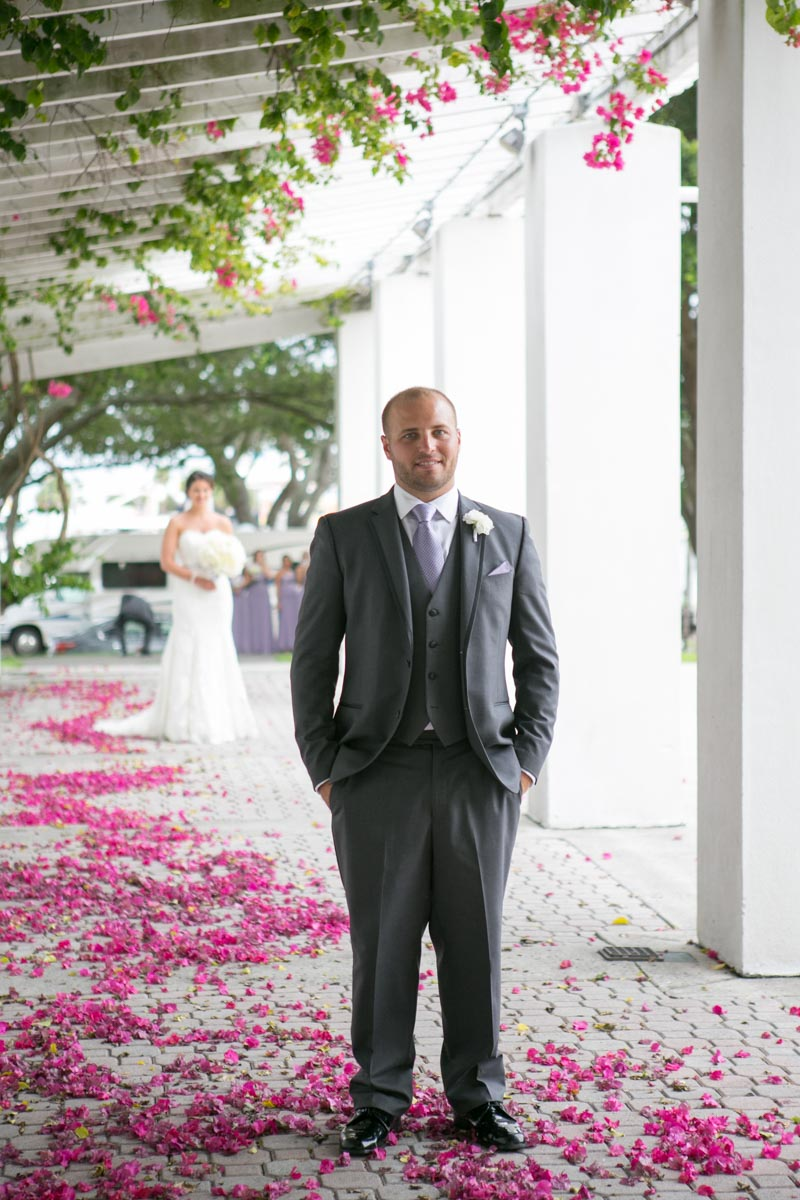 Groom Portrait with Bride in Background