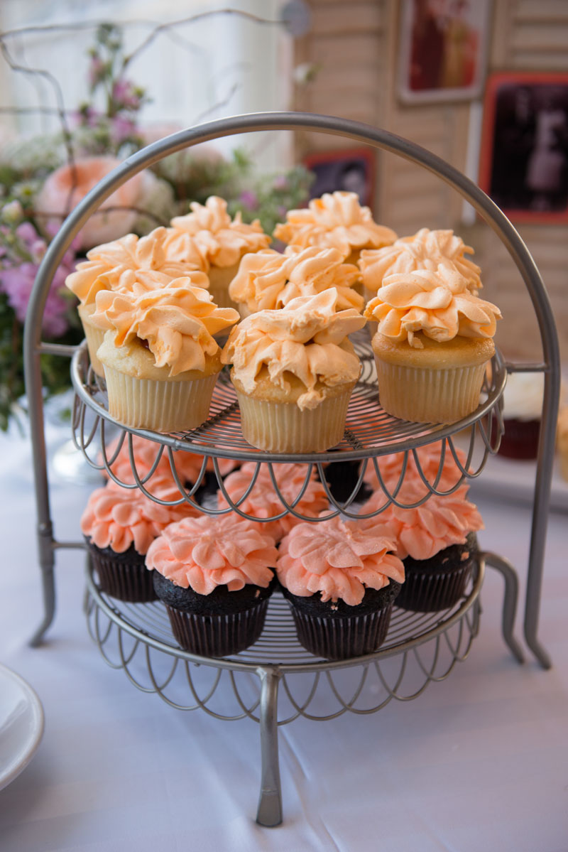 Light orange and pink iced vanilla and chocolate cupcakes