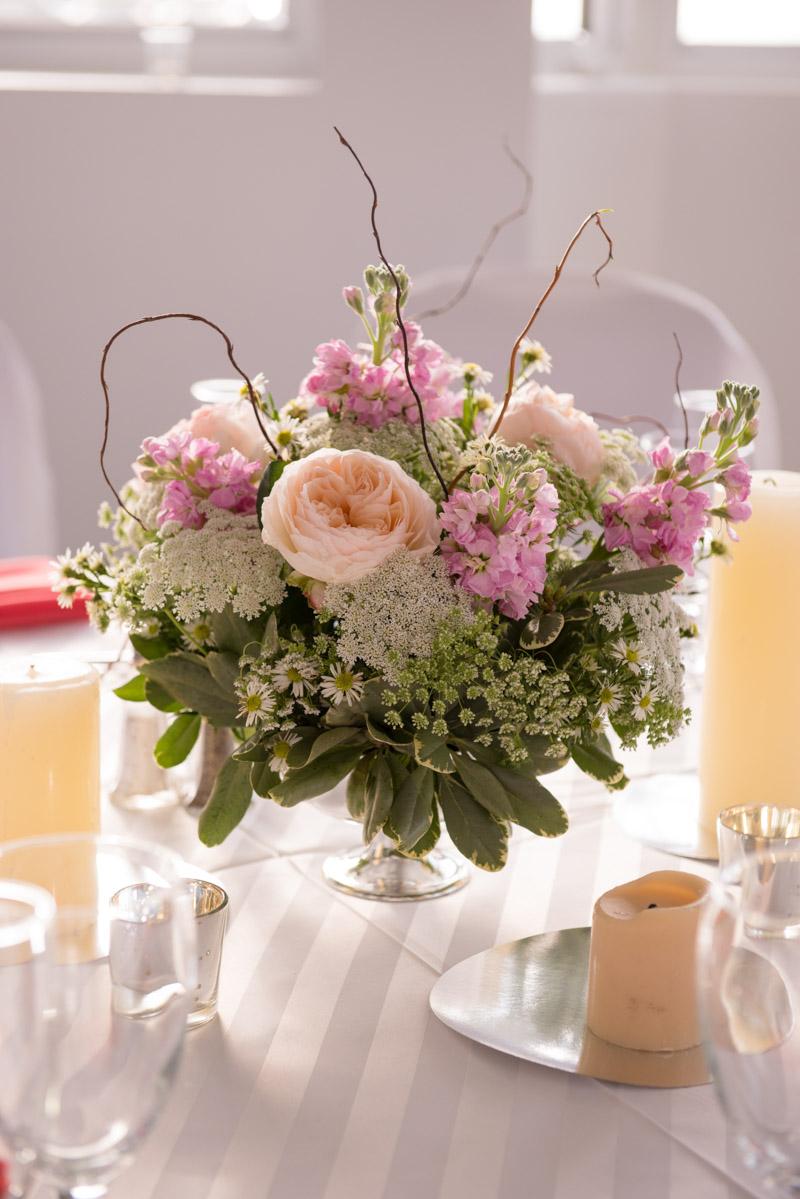 Pink garden rose with wildflowers centerpiece