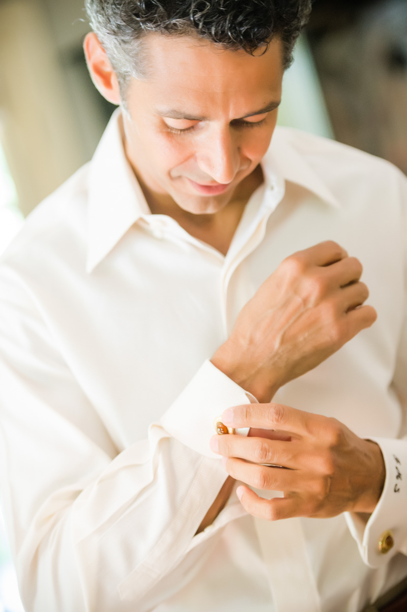 Shot of groom buttoning white cuff