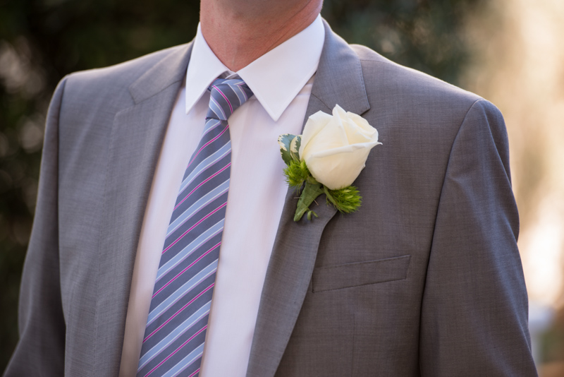 Striped red and blue tie with gray suit