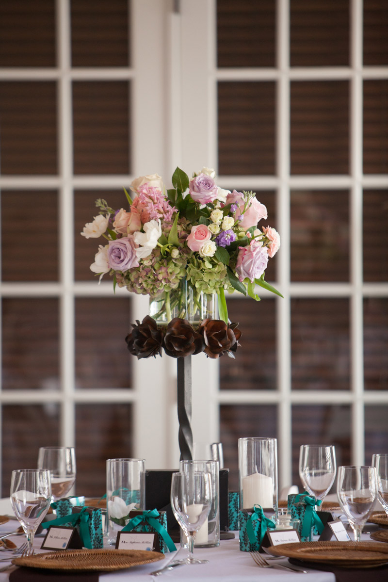 Tall pink, purple, and cream rose centerpiece