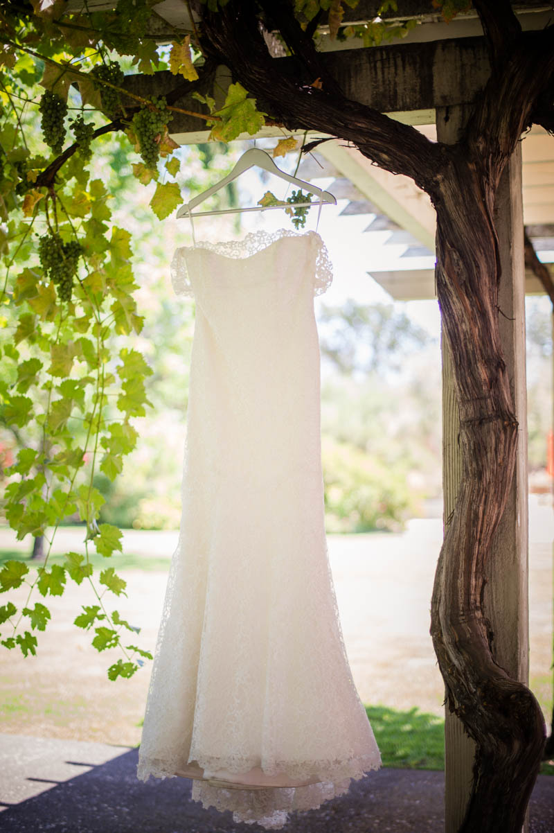 White lace bridal gown hanging