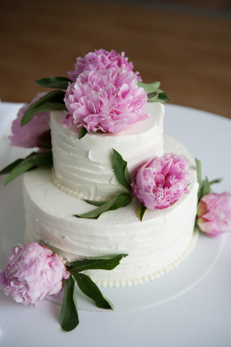 White two tier circle cake with pink cottage roses