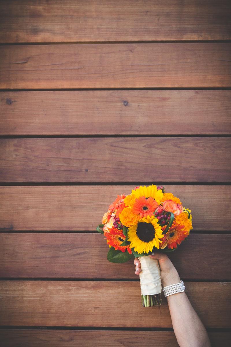 Yellow sunflower orange gerbera daisy orange carnation and rose bouquet rose