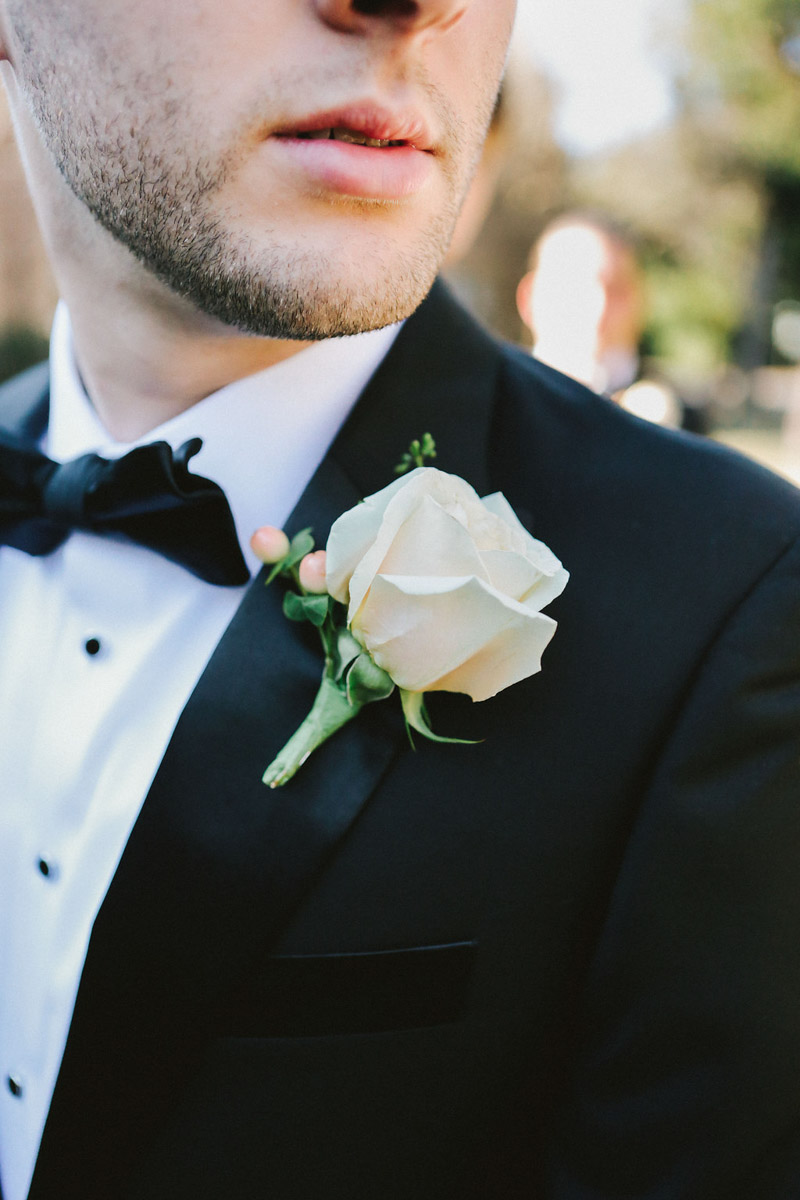 Alabama Groom in Black Tuxedo and Rose Boutonniere