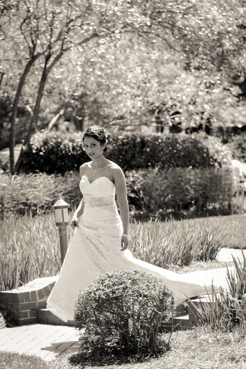 Black and white shot of bride walking to ceremony