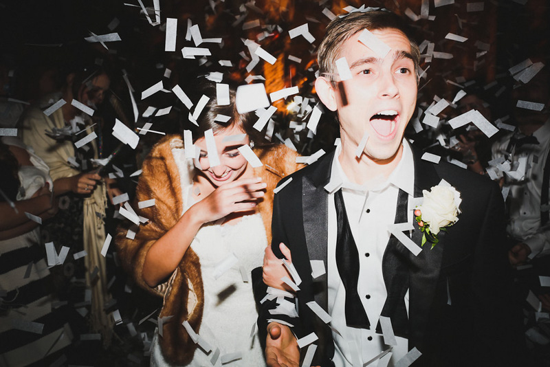 Bride and Groom Exit Through White Confetti