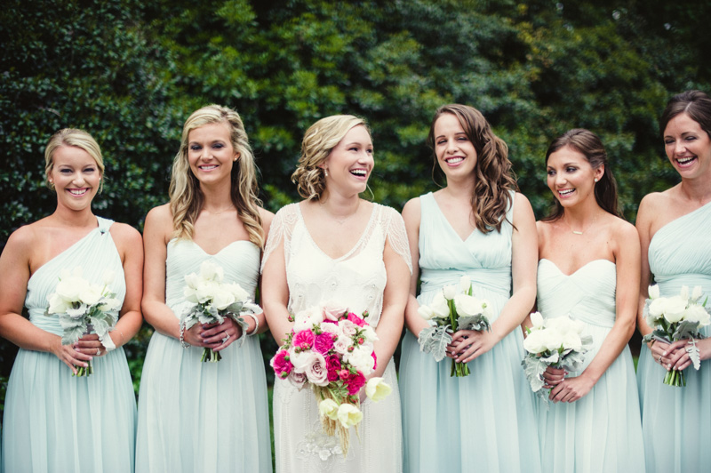 Bride and bridesmaids in light blue floor length gowns