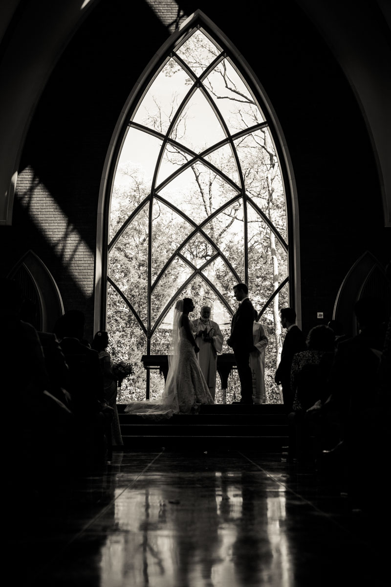 Bride and groom at the altar window