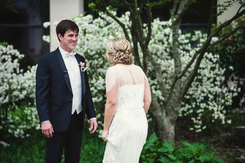 Bride and groom first look backshot in garden