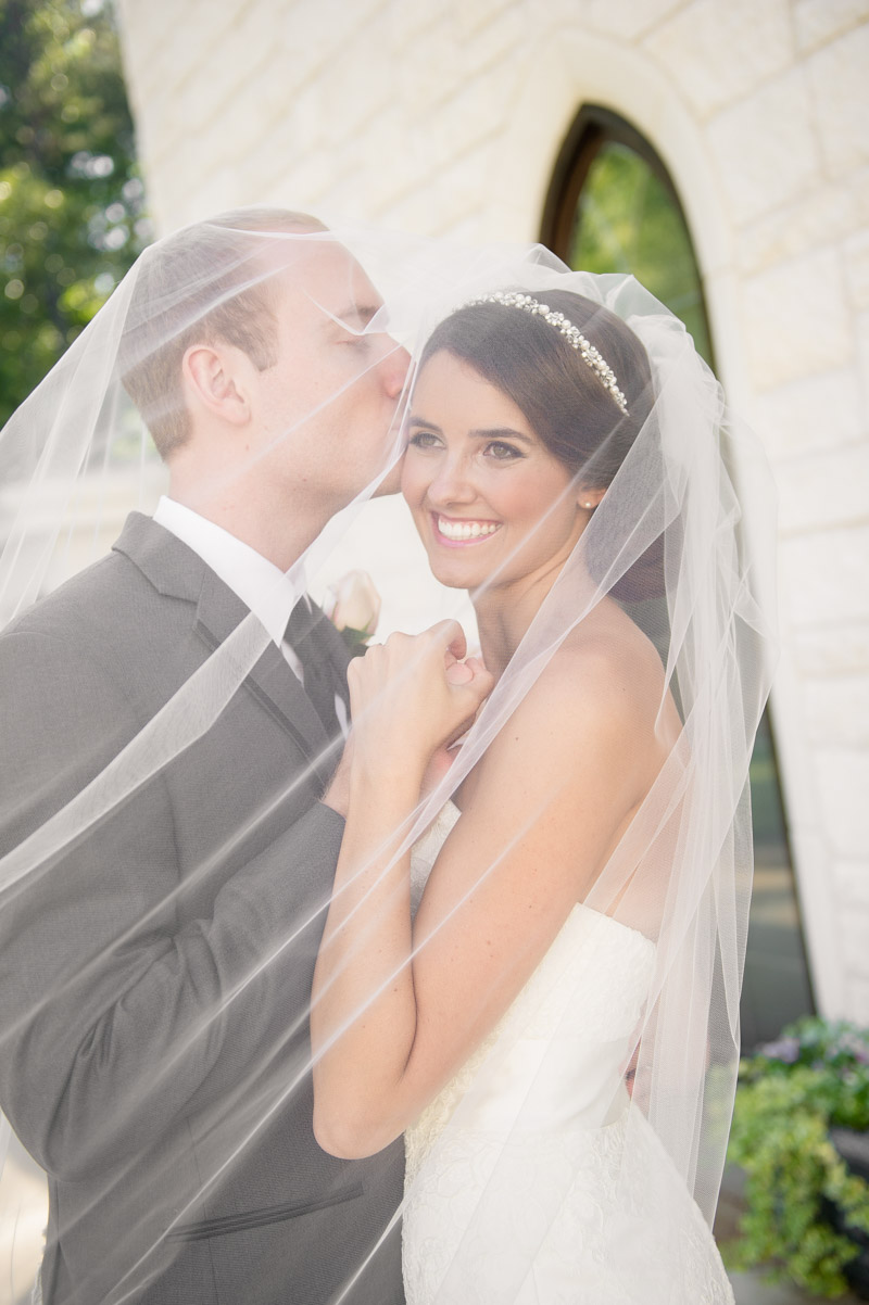 bride-and-groom-under-white-chiffon-veil