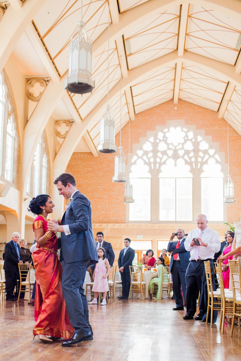 Bride in traditional Indian attire with groom during first dance