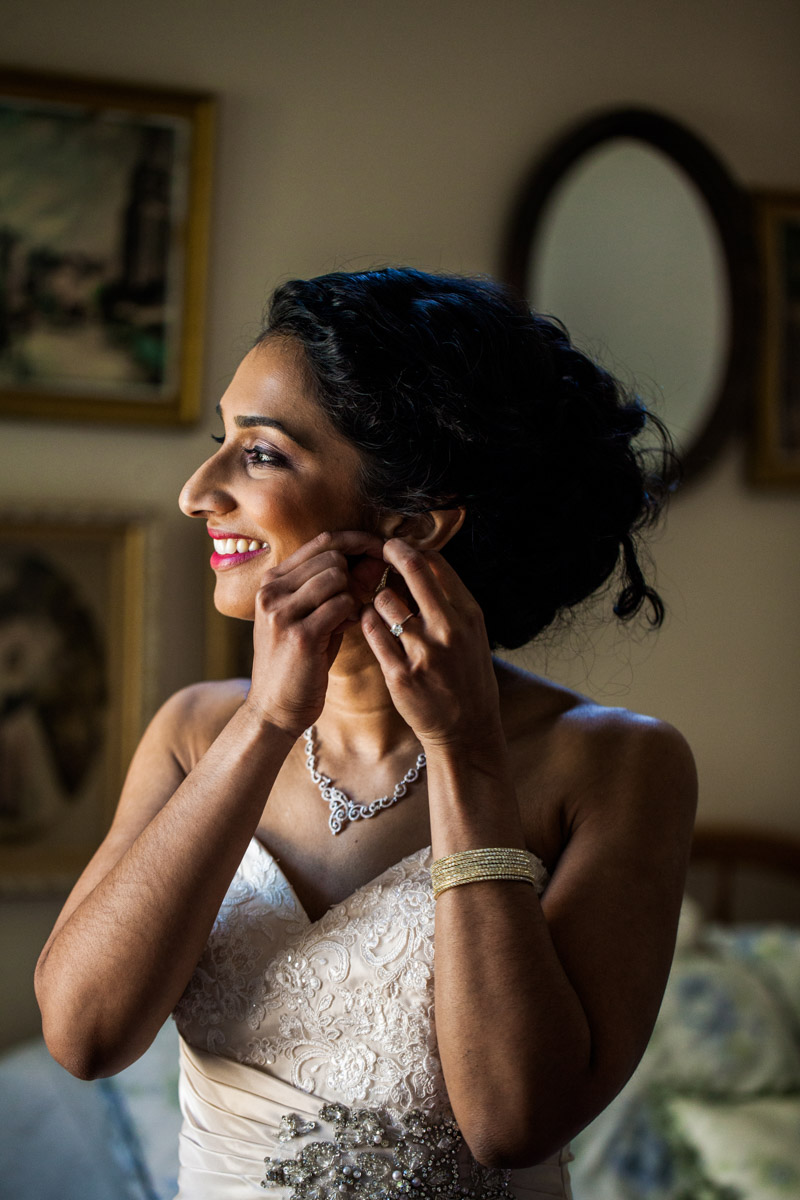 Bride putting on crystal accesories