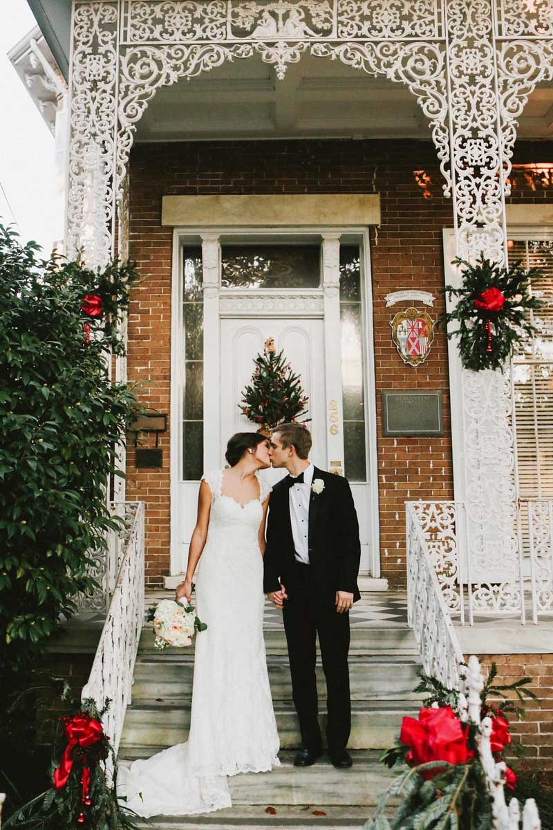 December Wedding Bride and Groom Outside Historic House