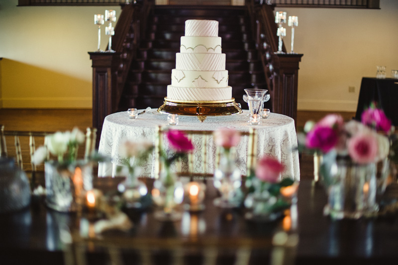 Distance shot of ivory and silver five tier circle wedding cake
