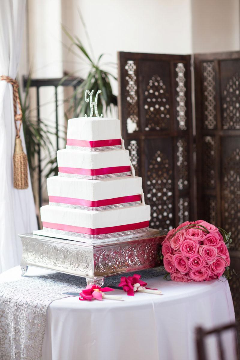 Glamorous Beachy Wedding Reception Cake with Pink Ribbon