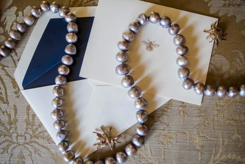 Gray pearls across navy and ivort inviations with gold beetle bug