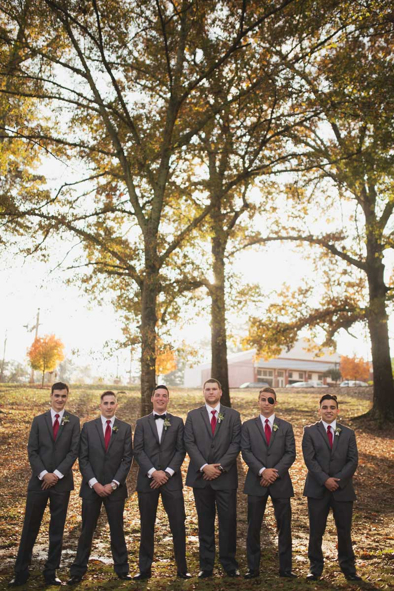 Groom and Groomsmen in Gray Tuxedos with Red Neckties