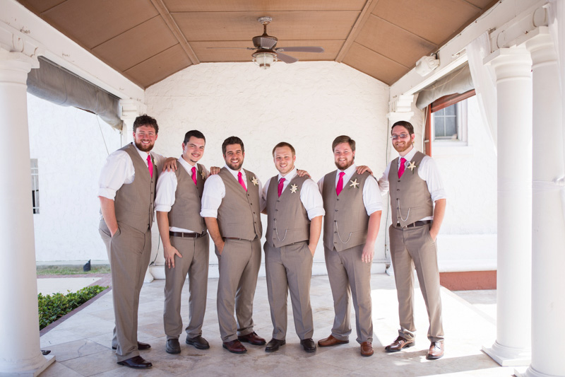 Groom and Groomsmen in Tan Suits and Fuchsia Ties