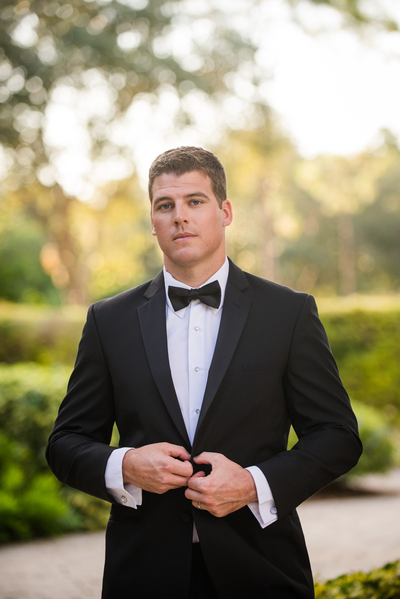Groom in classic black tuxedo with a black bow tie