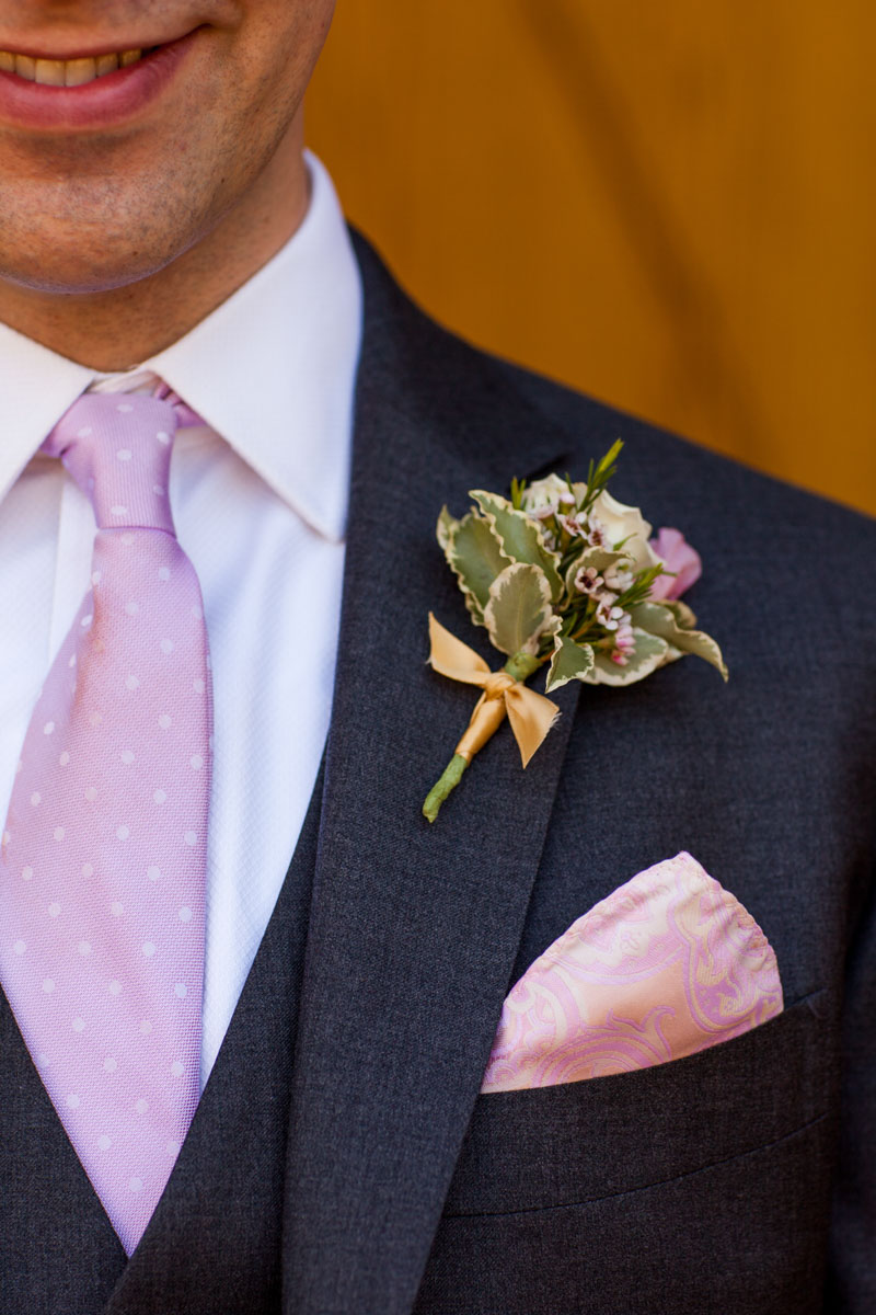 Groom with pink tie and succulent boutonniere_