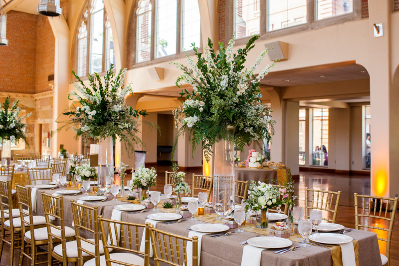 Large white stock centerpieces on nude table runners