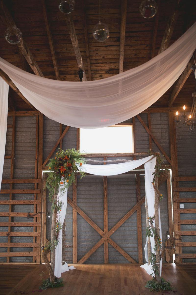 Rustic Indoor Arbor Wedding Ceremony Setup