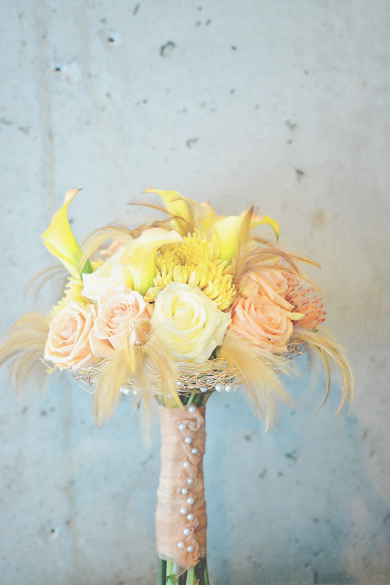 Blush rose, yellow rose, and peach feather bridal bouquet