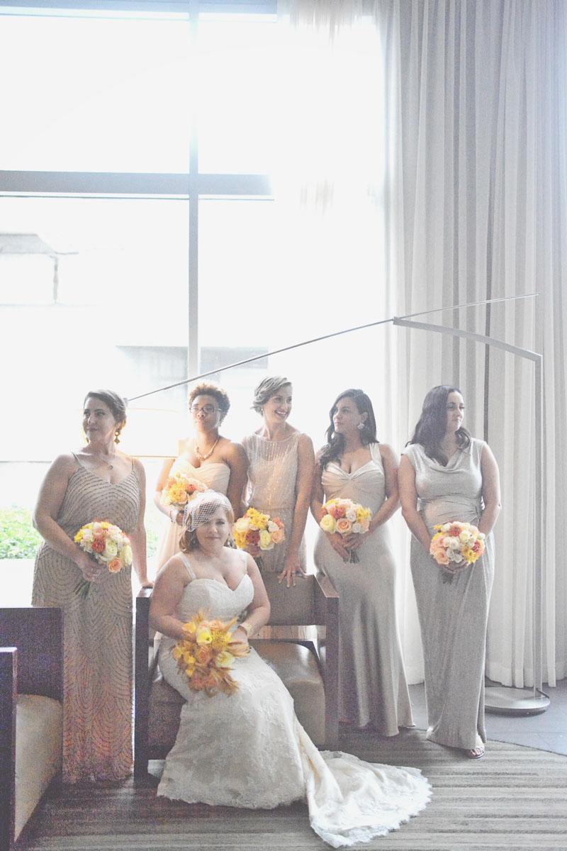 Bridal party in floor length champagne dresses_