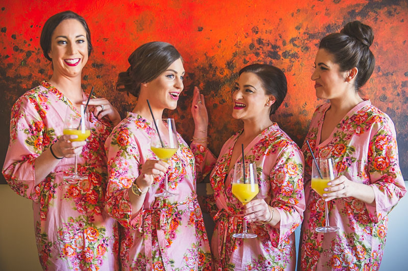 Bridal party in matching pink floral robes