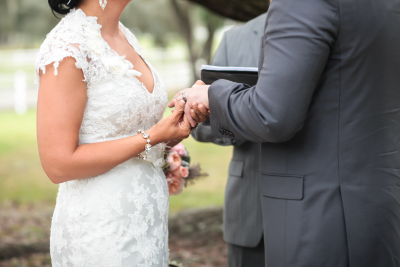 Bride and groom exhanging silver rings during ceremony