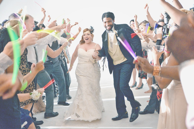 Bride and groom glow stick grand exit
