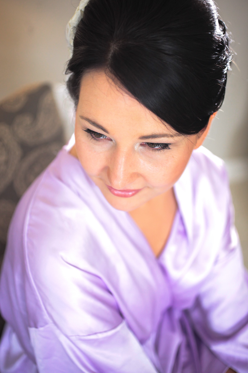 Bride getting ready in a silk purple robe