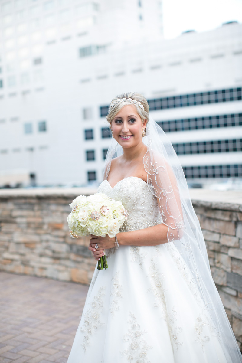 Bride with Beaded Veil and White Rose and Hydrangea Bouquet