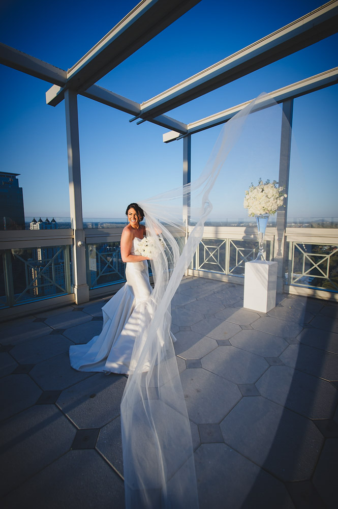 Bride's chiffon veil blowing in the wind